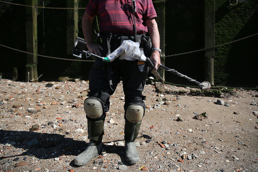 """Mudlarker Malcolm """"Mack"""" Macduff looks for items on the banks of the River Thames in London, Britain May 24, 2016. When the river Thames is at low tide, mudlarkers scour the shore for historical artefacts and remains from there City of London's ancient past. Finds can date back to Roman times to when the city was found up until more recent times. Anyone can walk along the river and look for finds, but the uses of metal detectors and digging is restricted. Mudlarkers need to be licences by the Port of London Authority. All find should be register with the Museum of London. REUTERS/Neil Hall"""