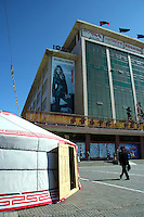 "State Department Store of Mongolia.  Still the best place to shop in Ulan Bator, despite its communist-sounding name. Flash western clothes and cosmetics are available - note the billboard. ""Ger' dwellings are also for sale here."