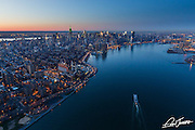 Aerial view of New York City looking up the East River on Saint Patrick's Day, photographed from a helicopter.