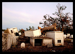 3rd November, 2005. Merrick Cemetery, St Bernard Parish just outside New Orleans, Louisiana in the aftermath of Hurricane Katrina. FEMA contractors are still removing coffins from the graveyard destroyed by the storm. Merrick cemetery was one of the earliest slave cemeteries in the south and was deluged by 20ft of flood water.