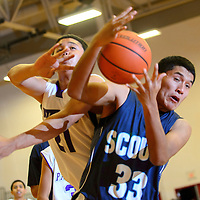121313  Adron Gardner/Independent<br /> <br /> Miyamura Patriot Anthony Lee (21), left, and Window Rock Scout Myron Wauneka (33) vie for a rebound during the Eddie Peña Classic in Grants Friday.