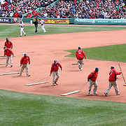 Ground staff prepare the infield during the Boston Red Sox V Tampa Bay Rays, Major League Baseball game on Jackie Robinson Day, Fenway Park, Boston, Massachusetts, USA, 15th April, 2013. Photo Tim Clayton