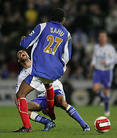 Photo: Lee Earle.<br /> Portsmouth v Chelsea. The Barclays Premiership. 03/03/2007.Portsmouth's Kanu (R) clashes with Chelsea's Ashley Cole.