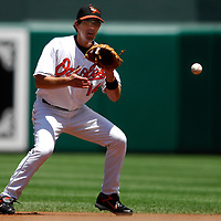 01 July 2007:  Baltimore Orioles first baseman Chris Gomez (14) fields a ground ball in the 3rd inning hit by Los Angeles Angels second baseman Erick Aybar.  The Angels defeated the Orioles 4-3 at Camden Yards in Baltimore, MD.   ****For Editorial Use Only****