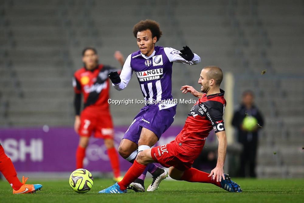 Martin Braithwaite / Lionel Mathis - 20.12.2014 - Toulouse / Guingamp - 17eme journee de Ligue 1 <br />Photo : Manuel Blondeau / Icon Sport