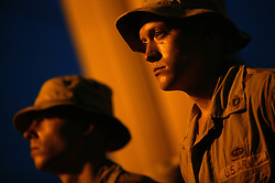 PFC Eugene Clark listens with other soldiers from the 2nd Battalion 325th Airborne Infantry Regiment 82nd Airborne Division during a memorial for Staff Sergeant Brian Hellerman and Private Kyle Gilbert, Baghdad, Iraq, Aug. 10, 2003. The two soldiers were killed in an attack by Iraqi resistance Aug. 6, 2003.