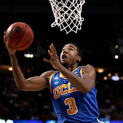 Mar 19, 2011; Tampa, FL, USA; UCLA Bruins guard Malcolm Lee (3) shoots against the Florida Gators during second half of the third round of the 2011 NCAA men's basketball tournament at the St. Pete Times Forum. Florida defeated UCLA 73-65.  Mandatory Credit: Derick E. Hingle