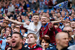 Supporters celebrate after Aston Villa win the match 2-1 to reach the 2015 FA Cup Final - Photo mandatory by-line: Rogan Thomson/JMP - 07966 386802 - 19/04/2015 - SPORT - FOOTBALL - London, England - Wembley Stadium - Aston Villa v Liverpool - FA Cup Semi Final.