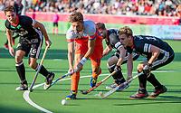 ANTWERPEN - Bjorn Kellerman (Ned) tussen Dieter Linnekogel (Ger) , Martin Haner (Ger) en Ferdinand Weinke (Ger)  tijdens  de troostfinale mannen om de derde plaats, Duitsland-Nederland (0-4) ,  bij het Europees kampioenschap hockey.    COPYRIGHT KOEN SUYK