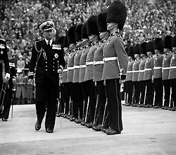 File photo dated 17/08/52 of the Duke of Edinburgh in Naval uniform inspecting the guard of honour mounted by the Scots Guards, when he officially opened the International Festival of Music and Drama, at Edinburgh castle. He was the Queen's husband and the royal family's patriarch, but what will the Duke of Edinburgh be remembered for? Issue date: Friday April 4, 2021.