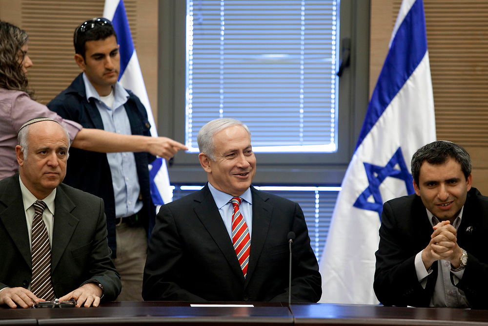 Israel's Prime Minister Benjamin Netanyahu (C), MK Ze'ev Elkin (R) and MK Zion Pinyan attend a Likud faction meeting in the Knesset, Israel's parliament, in Jerusalem on May 30, 2011.