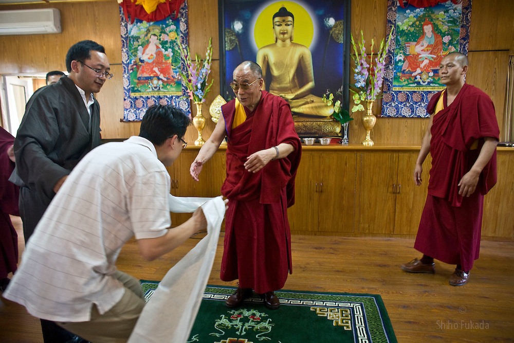 INDIA - Dalai Lama <br /> Dalai Lama receives khata, a white scarf given to honor higher Tibetan Lama, from a Buddhist after the audience meeting with Taiwanese Buddhists group in Dharamsala, India, May 26, 2009.