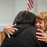 Author Charlotte J. Frisbie, hugs the great granddaughter Tall Woman, Kimberly Sandoval, during the book signing at the Octavia Fellin Public Library  in Gallup.