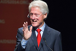 © Licensed to London News Pictures. 23/07/2014. Former US President Bill Clinton waves his hand while speaking during a session of the 20th International AIDS conference held in Melbourne Australia. Photo credit : Asanka Brendon Ratnayake/LNP
