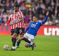 Brentford's Frank Onyeka (left) is tackled by Leicester City's Youri Tielemans (right) <br /> <br /> Photographer David Horton/CameraSport<br /> <br /> The Premier League - Brentford v Leicester City - Sunday 24th October 2021 - Brentford Community Stadium - Brentford<br /> <br /> World Copyright © 2021 CameraSport. All rights reserved. 43 Linden Ave. Countesthorpe. Leicester. England. LE8 5PG - Tel: +44 (0) 116 277 4147 - admin@camerasport.com - www.camerasport.com