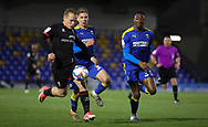 Lincoln City Midfielder Anthony Scully (11) is challenged by Paul Kalambayi of AFC Wimbledon  during the EFL Sky Bet League 1 match between AFC Wimbledon and Lincoln City at Plough Lane, London, United Kingdom on 2 January 2021.
