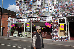 """© licensed to London News Pictures. London, UK 06/08/2012. The House of Reeves furniture store which was burnt down in last year's riots has been rebuilt and ready to be launched again on 08/08/12. The shop has been covered in 4000 images of young people with positive messages on August 6, 2012 in Croydon. The youth volunteering charity """"vInspired"""" are marking the one year anniversary of the riots in Croydon by displaying thousands of images of young Britons holding up positive messages about themselves on the House of Reeves furniture store which was destroyed in last year's violence. Photo credit: Tolga Akmen/LNP"""