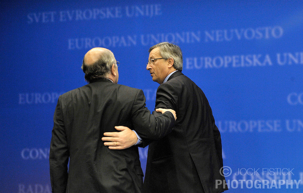 Jean-Claude Juncker, Luxembourg's prime minister and president of Euro Group, right, speaks with Joaquin Almunia, the EU's commissioner for economic and monetary affairs, following their Euro Group news conference in Brussels, Belgium, Monday, Feb. 9, 2009.  (Photo © Jock Fistick)