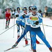 KUUSAMO 20021201<br /> World Cup Skiing in Kuusamo, Rauka, Finland, Sunday, December 1 2002. PIC: Pietro Piller Cottrer (ITA) in the lead during the mixed relay race.<br /> PHOTO: Bjorn Sigurdson/SCANPIX Code 20520