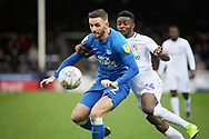 Coventry City forward Bright Enobakhare (24) and Peterborough Utd defender Jason Naismith (2) during the EFL Sky Bet League 1 match between Peterborough United and Coventry City at London Road, Peterborough, England on 16 March 2019.