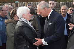 The Prince of Wales meets resident Marylyn Morris at the Aberfan Memorial Garden in Aberfan, Wales on the 50th anniversary of the tragedy.