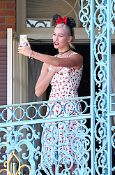 """EXCLUSIVE: Karlie Kloss celebrates her 25th birthday with a $15,000 lunch at Disneyland. Karlie celebrated the day with her family including her mother and sister and extended family. they rode rides including space mountain and splash mountain but they made the biggest splash by visiting the ultra exclusive and very expensive Royal 21 restaurant. Eating at this restaurant costs $15,000. while this restaurant is very exclusive, it is """"open to the public,"""" to those who can afford it. The restaurant is located in Walt Disney's old apartment which is located above the Pirates of the Caribbean ride. Karlie spent a lot of time on her phone face timing many friends and taking silly selfies around the park. she was all smiles and was even happy to take pictures with fans.She wore a white dress with printed cherries on it, Minnie mouse ears and a birthday pin around her waist. 04 Aug 2017 Pictured: Karlie Kloss. Photo credit: Snorlax / MEGA TheMegaAgency.com +1 888 505 6342"""