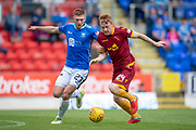 Liam Gordon (#23) of St Johnstone FC and Danny Johnson (#24) of Motherwell FC tussle for the ball during the Ladbrokes Scottish Premiership match between St Johnstone and Motherwell at McDiarmid Stadium, Perth, Scotland on 11 May 2019.