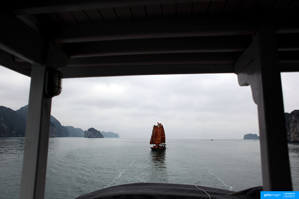 A tourist Junk with traditional sails sailing in Ha Long Bay, Vietnam. The bay consists of a dense cluster of 1,969 limestone monolithic islands. Ha Long Bay, is a UNESCO World Heritage Site, and a popular tourist destination. Ha Long, Bay, Vietnam. 11th March 2012. Photo Tim Clayton