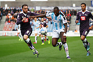 Richard Keogh (l) of Derby County and Ishmael Miller of Huddersfield town chase the ball. Skybet football league Championship match, Huddersfield Town v Derby county at the John Smith's Stadium in Huddersfield , Yorkshire on Saturday 24th October 2015.<br /> pic by Chris Stading, Andrew Orchard sports photography.