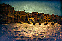 """""""Silhouette of Gondoliers against the late sun on the Grand Canal near the Church of Santa Maria del Giglio - Green Water""""…<br /> """"Venice"""" - Henry Wadsworth Longfellow: <br /> WHITE swan of cities, slumbering in thy nest<br /> So wonderfully built among the reeds<br /> Of the lagoon, that fences thee and feeds,<br /> As sayeth thy old historian and thy guest!<br /> White water-lily, cradled and caressed<br /> By ocean streams, and from the silt and weeds<br /> Lifting thy golden pistils with their seeds,<br /> Thy sun-illumined spires, thy crown and crest!<br /> White phantom city, whose untrodden streets<br /> Are rivers, and whose pavements are the shifting<br /> Shadows of palaces and strips of sky;<br /> I wait to see thee vanish like the fleets<br /> Seen in mirage, or towers of cloud uplifting<br /> In air their unsubstantial masonry.<br /> <br /> The gondola is a traditional, flat-bottomed Venetian rowing boat, well suited to the conditions of the Venetian lagoon. The rowing oar, which is not fastened to the hull, is used in a sculling manner, also acting as the rudder. For centuries the gondola was the chief means of transportation and most common watercraft within Venice. It is propelled by a gondolier. In modern times the iconic boats still have a role in public transportation in the city, serving as traghetti (ferries) over the Grand Canal. There are just over four hundred gondolas in active service today, virtually all of them used for hire by tourists. In order to become a professional gondolier, you need to obtain a license from the guild. Two hundred years ago, there were 10,000 gondolas in Venice. Although the aristocracy preferred horses to boats through the early Middle-Ages, beginning in the 14th century when horses were outlawed from the streets of Venice, the noble class embraced gondolas as a respectable form of transportation."""