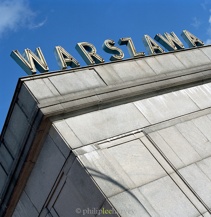 """""""Warsaw"""" sign on top of a building in Warsaw, Poland"""