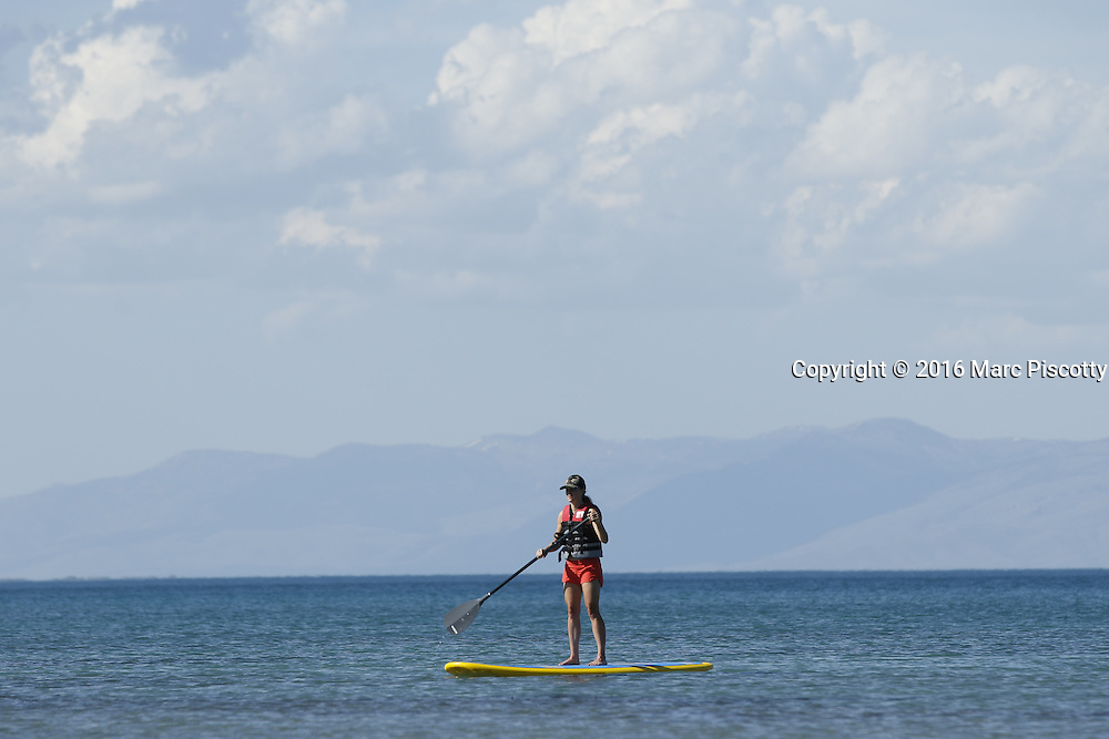 """SHOT 6/9/16 4:21:25 PM - Bear Lake is a natural freshwater lake on the Utah-Idaho border in the Western United States. About 109 square miles in size, it is split about equally between the two states. The lake has been called the """"Caribbean of the Rockies"""" for its unique turquoise-blue color, which is due to the reflection of calcium carbonate (limestone) deposits suspended in the lake. The lake is a popular destination for tourists and sports enthusiasts, and the surrounding valley has gained a reputation for having high-quality raspberries. (Photo by Marc Piscotty / © 2016)"""