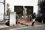 a classic male nude statue in the front garden of house in Tokyo Japan