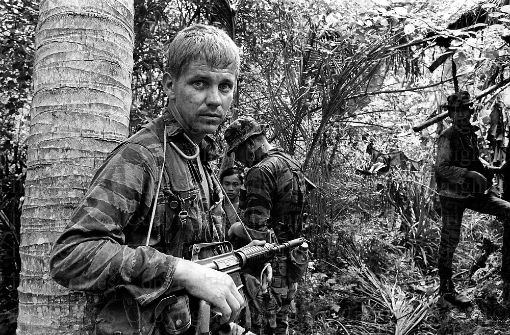 American Special Forces seen during a patrol in the Central Highlands with a unit of the South Vietnamese Army. October 1970. The Vietnam War was fought between 1st November 1955 until the fall of Saigon on 30 April 1975. Photographed by  Terry Fincher.