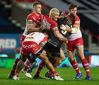 Rugby League - 2020 Betfair Super League - Semi-final - St Helens vs Catalan Dragons - TW Stadium<br /> <br /> Catalans Dragons's Samisoni Langi is tackled <br /> <br /> COLORSPORT/TERRY DONNELLY