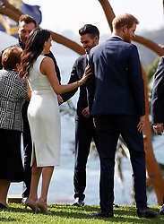The Duke and Duchess of Sussex in the grounds of Admiralty House in Sydney on the first day of the royal couple's visit to Australia.