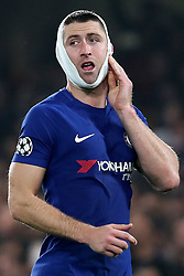 18 October 2017 - UEFA Champions League - Chelsea v AS Roma - Gary Cahill of Chelsea touches a bandage covering his head and jaw - Photo: Charlotte Wilson / Offside