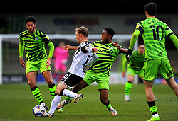 Tom Conlon of Port Vale competes with Ebou Adams of Forest Green Rovers- Mandatory by-line: Nizaam Jones/JMP - 16/01/2021 - FOOTBALL - innocent New Lawn Stadium - Nailsworth, England - Forest Green Rovers v Port Vale - Sky Bet League Two