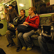 "World Champion same-sex ballroom dancers Robert Tristan Szelei, second from right, and Gergely Darabos, third from right, ride the subway in Budapest, Hungary from a practice session on October 19, 2006, as they prepare for the 2nd annual World Championship Same-Sex Ballroom Dancing competition, held in their hometown on October 21, 2006. ..Szelei and Darabos, who are known as the ""Black Swans,"" are the reigning world champions in men?s Latin same-sex ballroom dancing. They have been training and preparing to host the 2nd annual World Championship and the Csardas Cup, the first-ever Eastern European same-sex ballroom competition, both held at the Korcsarnok arena.  This is the pinnacle event of the blossoming same-sex ballroom scene...Szelei and Darabos went on to win the men?s Standard division and finished fourth in the Latin division. ..The event was organized by the US-based World Federation of Same-Sex Dancing, which hosted the first World Championship Same-Sex championships in 2005 in Sacramento, California. The Black Swans did a large amount of the coordination and planning in Budapest, a city that had never seen an event of this kind. When government funding fell through, they secured funding from patron Desire (accent on the ?e?) Dubounet, owner of the local Club Bohemian Alibi drag club. ..The World Championship events are newly recognized, but same-sex dancers have been competing on a national and international circuit for a number of years, especially in Europe, including at the Eurogames, the Gay Games, the London Pink Jukebox Trophy and the Berlin Open, among others. Countries including the United States, the Netherlands, Germany and, now, Hungary, hold their own national same-sex championships. Hungary held its first national championships in April 2006...Szelei and Darabos spent three months at the Sacramento Dancesport same-sex dance school in California this summer, on the first scholarship offered by the World Federation. The men both got their ea"