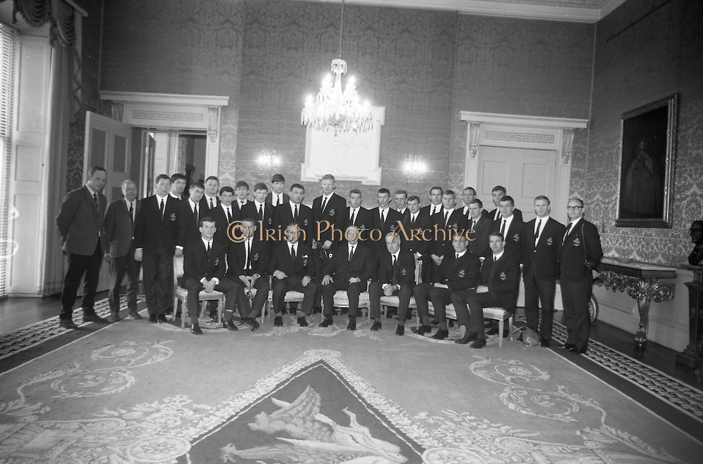 President of Ireland de Valera received the members and officias of the Irish Rugby touring team at Aras an Uachtatain, Phoenix Park, Dublin, Saturday 22.4.67,.The team later departed for New York from Dublin Airport, en route to Australia,.Picture shows the President, centre, with officials and members of the team,..Irish Rugby Football Union, Irish team departs for Australian tour, 22nd April 1967, 22.4.67, 4.22.67,.
