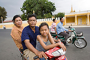 Chanthy with her mother take a ride with her father, driving his scooter, around Phnom Penh..Chanthy, a young girl, learns the Apsara traditional Khmer dance style, at the School of Beaux Arts outside Phnom Penh. This dance style is particularly inspired by thousands of Apsara statues found at Angkor Wat and performed by the Cambodia Royal Ballet. Chanthy lives with her family in Phnom Penh, her father is a policeman, and her family lives in a municipal apartment block surrounded by other families. Chanthy has good friends including a Chinese girl who is mentally handicapped and lives next door. She loves to visit Phnom Penh city and sites with her mother and father, on his scooter.