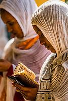 Women praying, Saint Yared Church (Ethiopian Orthodox Church), Axum (Aksum), Ethiopia.