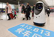ZHENGZHOU, CHINA - FEBRUARY 15: <br /> <br /> Police Robot Patrols At Zhengzhou East Railway Station<br /> <br /> Passengers look at a police robot at Zhengzhou East Railway Station on February 15, 2017 in Zhengzhou, Henan Province of China. The police robot can do the cleaning, monitor the air quality, find fire and other dangerous in advance when it patrols at Zhengzhou East Railway Station. It can also recognize passengers\' faces to compare with the faces of the escaped criminals. <br /> ©Exclusivepix media