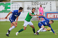 Christian Doidge (9) of Hibernian and Cove Rangers Blair Yule (8) battle for the ball during the Betfred Scottish League Cup match between Cove Rangers and Hibernian at Balmoral Stadium, Aberdeen, Scotland on 10 October 2020.