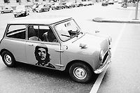 1974, Munich, West Germany --- Che Guevara Painted on Mini Car Door --- Image by © Owen Franken/CORBIS
