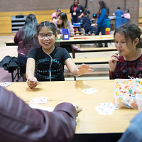 """On Thursday in Twin Lakes, Madeline Pasquale, 10, left, and Symphony Martinez, 10, right, play the card game """"War"""" during the Family Math Night held at Twin Lakes Elementary School."""