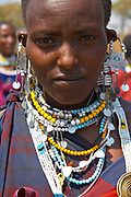 Portrait of a Maasai woman wearing j a large amount of handcrafted jewelry