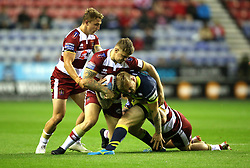 Wigan Warriors Ryan Sutton (left) and John Bateman (right) tackle Wakefield Trinity's Tom Johnstone during the Betfred Super League Super 8's match at the DW Stadium, Wigan.