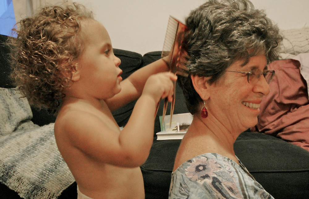 Active Aging Senior Citizens, Retired, Activities, Granddaughter Combs Grandmother's Hair