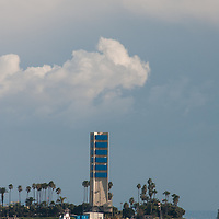 Palm trees and an artificial island disguise oil drilling and pumping equipment in Long Beach Harbor, California.